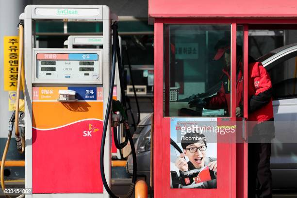 An attendant works near petrol pumps at an SK Energy Co gas station a unit of SK Innovation Co in Incheon South Korea on Tuesday Jan 31 2017 SK...
