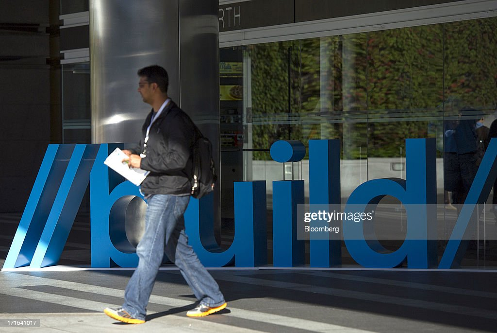 An attendee arrives at the Microsoft Corp. Build Developers Conference in San Francisco, California, U.S., on Wednesday, June 26, 2013. Microsoft Corp. is introducing a venture capital division that will provide funding, advice and computing and software services to startups. Photographer: David Paul Morris/Bloomberg via Getty Images