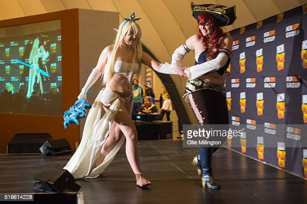 An attendee at Comic Con 2016 in cosplay as Janna and Miss Fortune from League of Legends competing in the MCM Masquerade as their favourite cult...