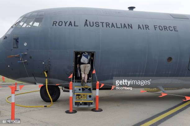 An attendee boards an Australian Defence Force C130J Super Hercules turboprop military transport aircraft manufactured by Lockheed Martin Corp on the...