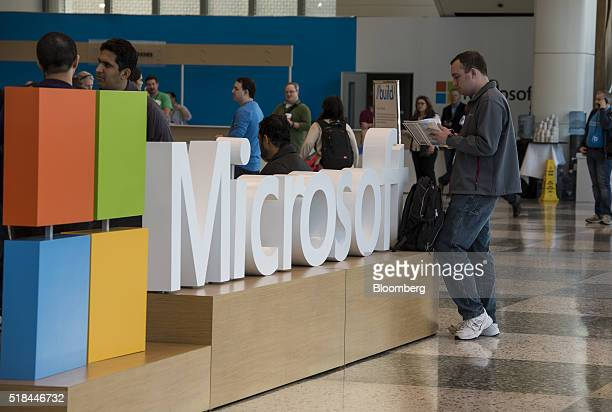 An attendee checks a schedule at the Microsoft Developers Build Conference in San Francisco California US on Thursday March 31 2016 Microsoft Chief...