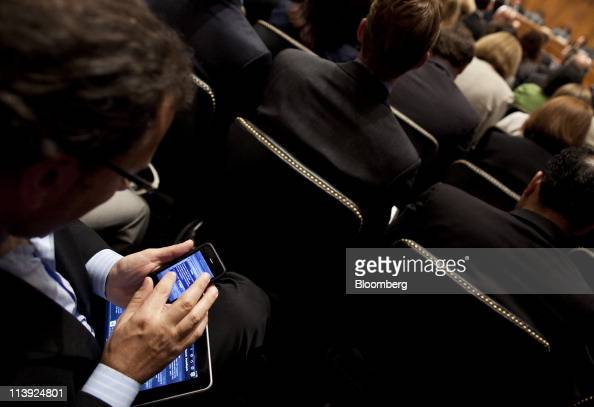 An attendee checks his mobile devices during a hearing of the Senate Judiciary Committee's Subcommittee on Privacy Technology and the Law in...