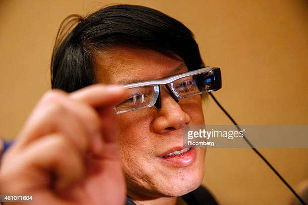 An attendee controls an Epson BT200 augmented reality headset manufactured by Seiko Epson Corp with Augumenta Ltd advanced gesturing technology...