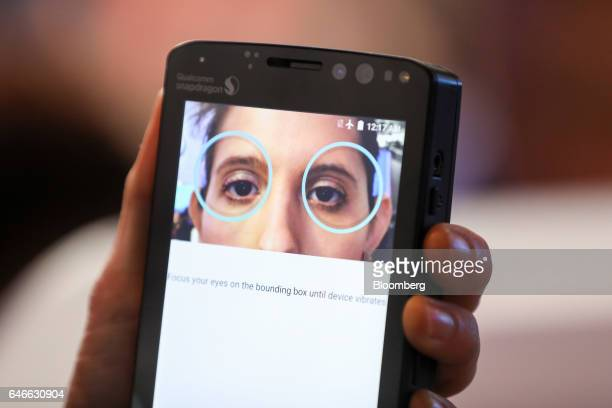 An attendee demonstrates the Qualcomm Iris Authentication Solution on the Qualcomm Inc stand on the third day of Mobile World Congress in Barcelona...