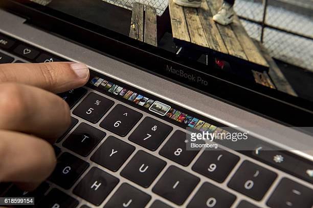 An attendee demonstrates the Touch Bar on the new MacBook Pro laptop computer during an event at Apple Inc headquarters in Cupertino California US on...