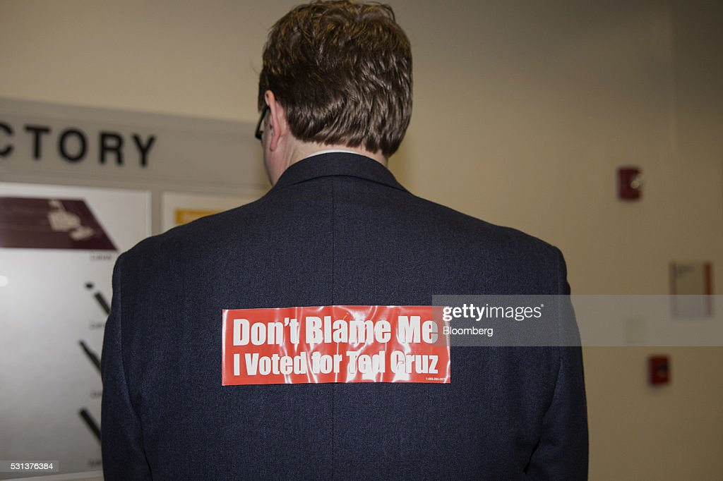 An attendee displays a bumper sticker on the back of his blazer reading 'Don't Blame Me I Voted For Cruz' during the 2016 Texas Republican Convention...
