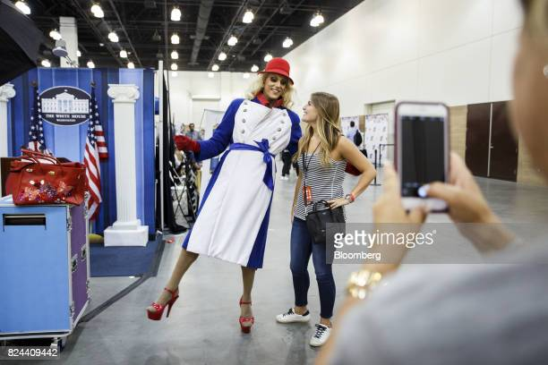 An attendee dressed in costume as Kellyanne Conway senior advisor to US President Donald Trump stands for a photograph during the Politicon...