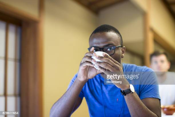 An attendee drinks a cup of Japanese tea during a cultural experience program part of Mitsubishi UFJ Financial Group Inc's Global Analyst Program for...