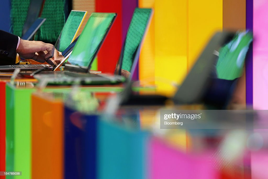 An attendee examines a laptop computer running Microsoft Corp's Windows 8 operating system during a launch event in Tokyo Japan on Friday Oct 26 2012...