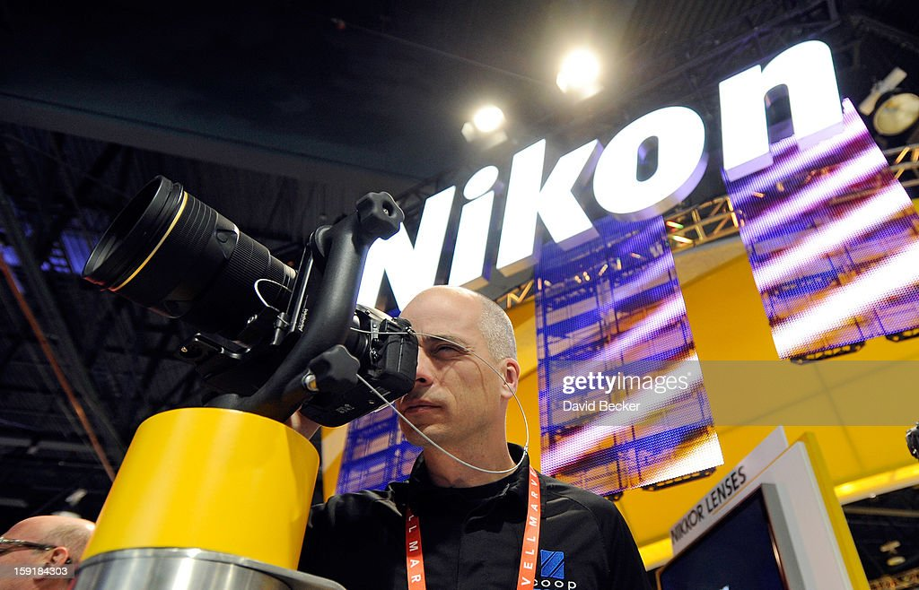 An attendee examines a Nikon camera at the 2013 International CES at the Las Vegas Convention Center on January 9, 2013 in Las Vegas, Nevada. CES, the world's largest annual consumer technology trade show, runs through January 11 and is expected to feature 3,100 exhibitors showing off their latest products and services to about 150,000 attendees.