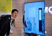 An attendee examines the Sony's X900C ultra slim 4K UHD TV at the 2015 International CES at the Las Vegas Convention Center on January 6 2015 in Las...