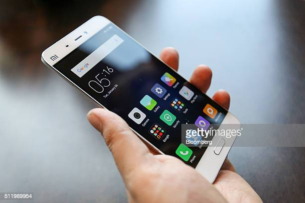 An attendee handles the Mi5 smartphone manufactured by Xiaomi Corp during its launch at the Mobile World Congress in Barcelona Spain on Wednesday Feb...