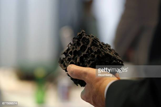 An attendee holds a 3D printed digital rock at the BP Plc booth during the 2017 Offshore Technology Conference in Houston Texas US on Wednesday May 3...