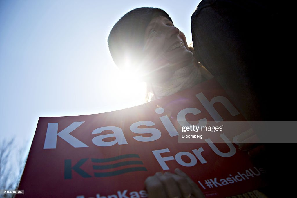 An attendee holds a campaign sign while waiting to greet John Kasich, governor of Ohio and 2016 Republican presidential candidate, not pictured, during a campaign rally outside Mutt's BBQ in Mauldin, South Carolina, U.S., on Saturday, Feb. 13, 2016. Kasich and fellow establishment candidates, Marco Rubio and Jeb Bush, are determined to make a stand in South Carolina in order to convince donors and supporters that they have a legitimate shot at winning the nomination. Photographer: Daniel Acker/Bloomberg via Getty Images