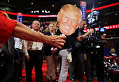 An attendee holds a Donald Trump mask on the floor prior to the start of the second day of the Republican National Convention on July 19 2016 at the...