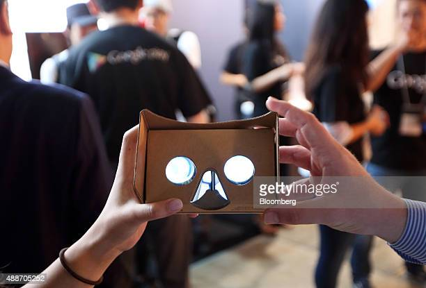 An attendee holds a Google Inc Cardboard virtual reality headset at the Tokyo Game Show 2015 at Makuhari Messe in Chiba Japan on Thursday Sept 17...