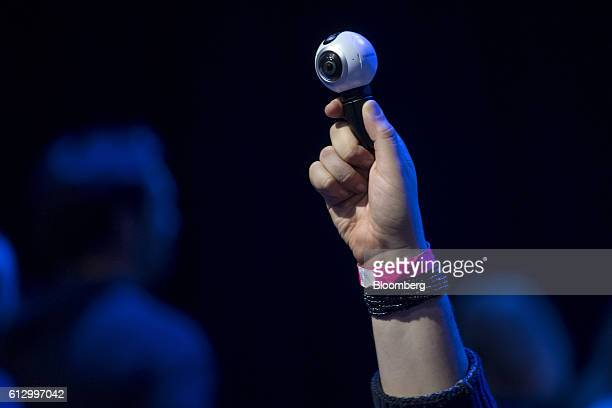 An attendee holds a Samsung Electronics Co Gear 360 camera during the Oculus Connect 3 event in San Jose California US on Thursday Oct 6 2016...