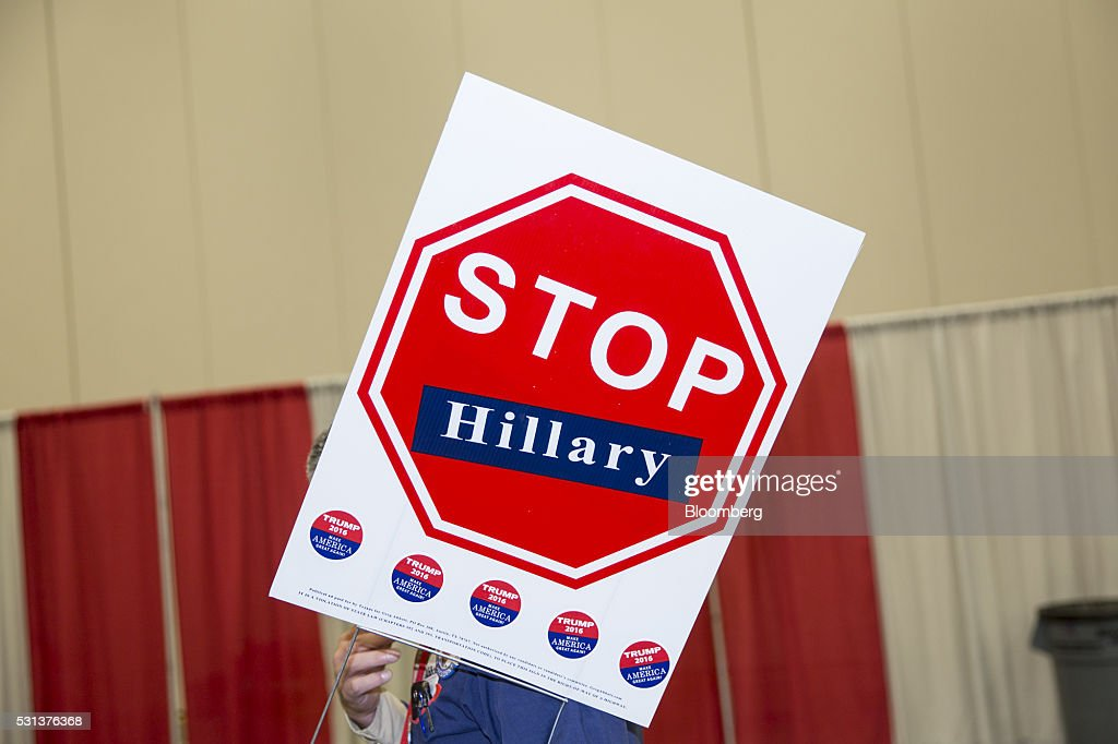 An attendee holds a 'Stop Hillary' sign during the 2016 Texas Republican Convention in Dallas Texas US on Saturday May 14 2016 Paul Ryan made clear...