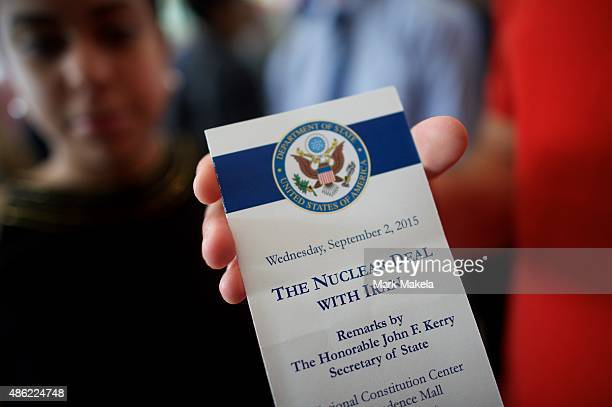 An attendee holds a ticket from the speech US Secretary of State John Kerry delivered on the nuclear agreement with Iran at the National Constitution...