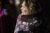An attendee holds an American flag before the start of a campaign event with Hillary Clinton presumptive 2016 Democratic presidential nominee not...