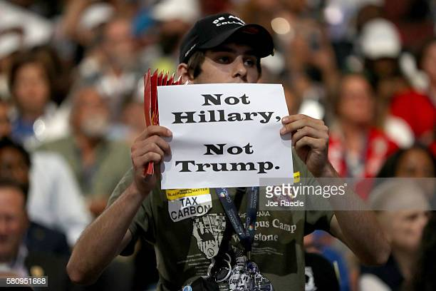An attendee holds up a sign that reads 'Not Hillary Not Trump' during the opening of the first day of the Democratic National Convention at the Wells...