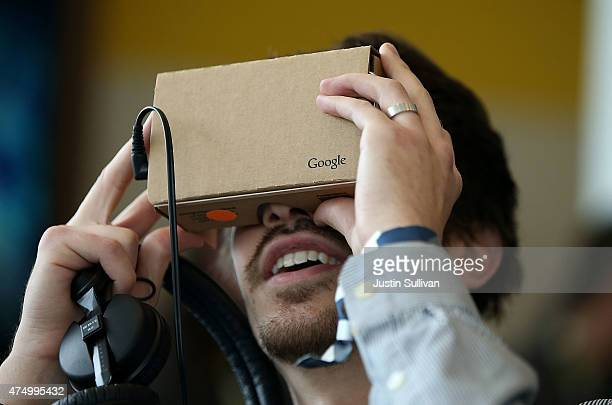 An attendee inspects Google Cardboard during the 2015 Google I/O conference on May 28 2015 in San Francisco California The annual Google I/O...