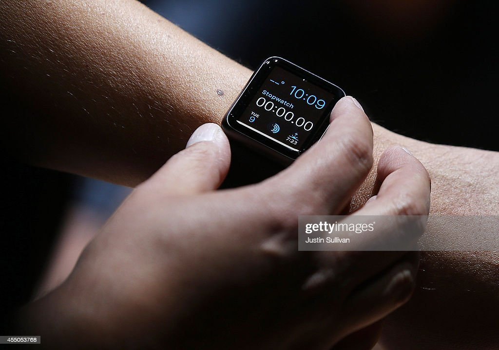An attendee inspects the new Apple Watch during an Apple special event at the Flint Center for the Performing Arts on September 9 2014 in Cupertino...