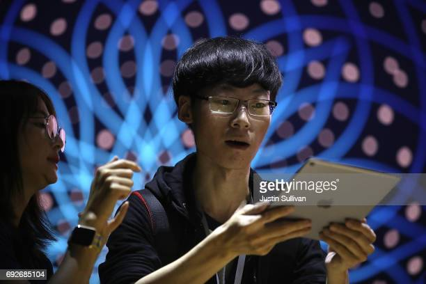 An attendee inspects the new iPad Pro during the 2017 Apple Worldwide Developer Conference at the San Jose Convention Center on June 5 2017 in San...