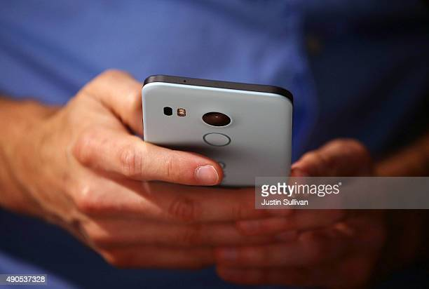 An attendee inspects the new Nexus 5X phone during a Google media event on September 29 2015 in San Francisco California Google unveiled its 2015...