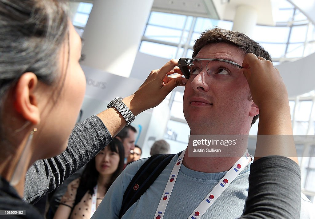 An attendee is fitted with Google Glass during the Google I/O developer conference on May 17, 2013 in San Francisco, California. Eight members of the Congressional Bi-Partisan Privacy Caucus sent a letter to Google co-founder and CEO Larry Page seeking answers to privacy questions and concerns surrounding Google's photo and video-equipped glasses called 'Google Glass'. The panel wants to know if the high tech eyeware could infringe on the privacy of Americans. Google has been asked to respond to a series of questions by June 14.