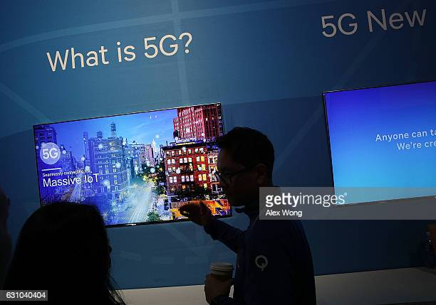 An attendee listens to information about 5G aka 5th generation mobile networks at the Qualcomm booth during CES 2017 at the Las Vegas Convention...