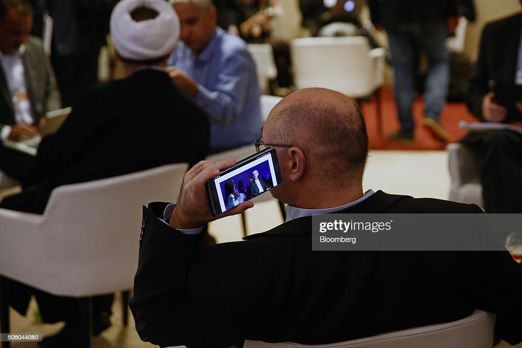 An attendee listens to speakers on his smartphone device between sessions during the World Economic Forum (WEF) at the World Economic Forum (WEF) in Davos, Switzerland, on Wednesday, Jan. 20, 2016. World leaders, influential executives, bankers and policy makers attend the 46th annual meeting of the World Economic Forum in Davos from Jan. 20 - 23. Photographer: Simon Dawson/Bloomberg via Getty Images