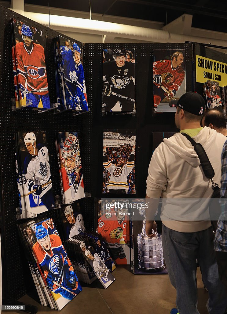 An attendee looks at a display featuring Frameworth products at the Sports Card and Memorabilia Expo at the Toronto International Centre on November 10, 2012 in Mississauga, Ontario, Canada.