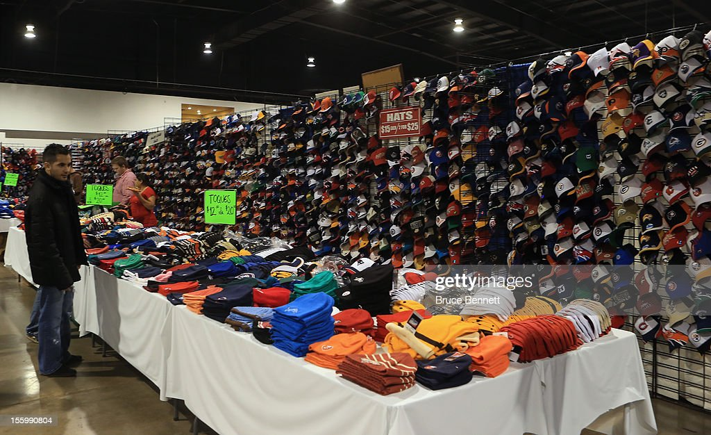 An attendee looks at a display featuring hats at the Sports Card and Memorabilia Expo at the Toronto International Centre on November 10, 2012 in Mississauga, Ontario, Canada.
