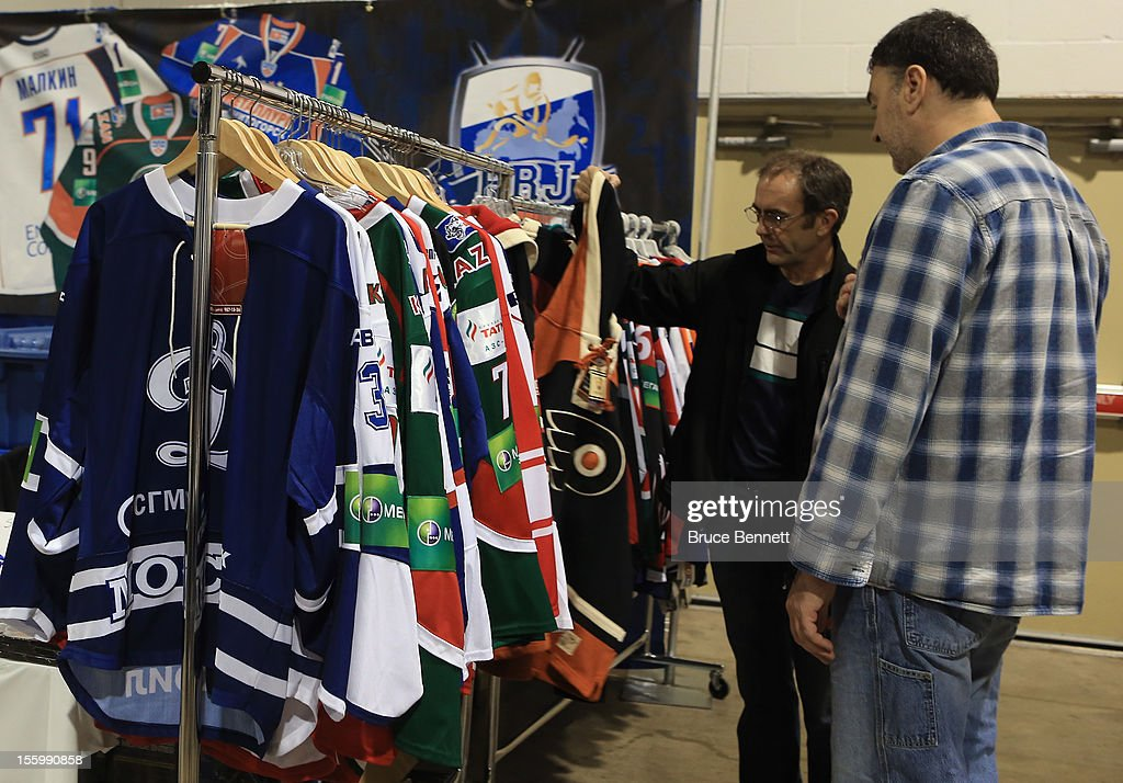 An attendee looks at a display featuring hockey jerseys at the Sports Card and Memorabilia Expo at the Toronto International Centre on November 10, 2012 in Mississauga, Ontario, Canada.