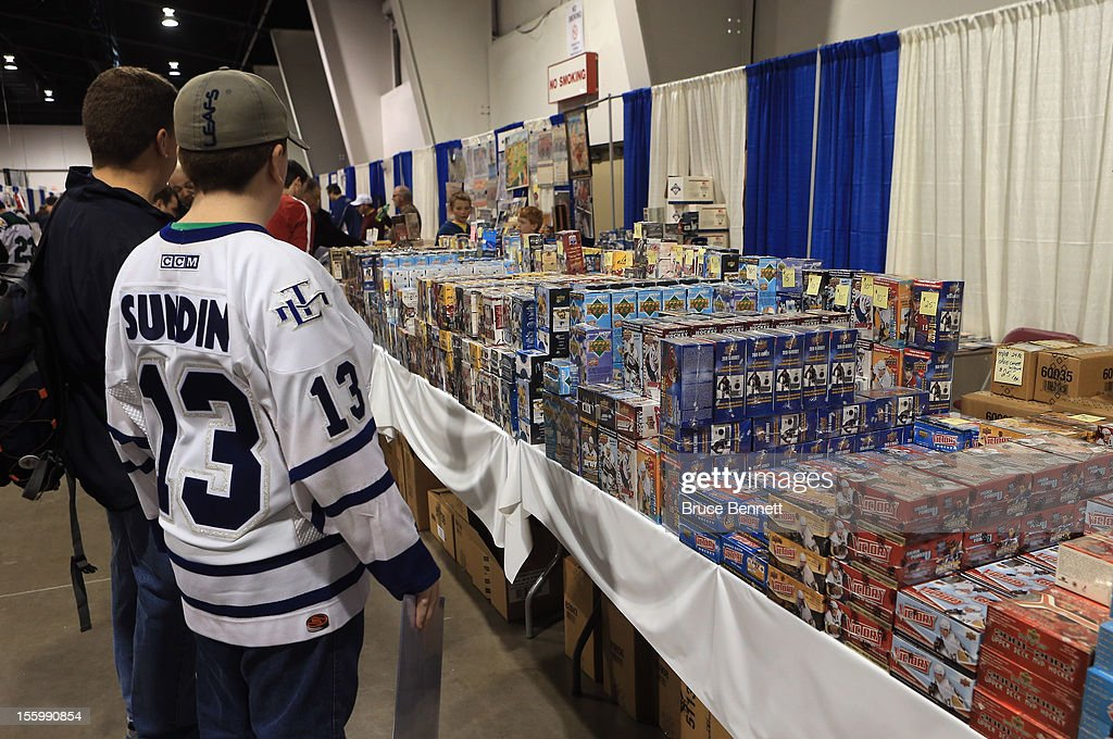 An attendee looks at a display featuring hockey trading cards at the Sports Card and Memorabilia Expo at the Toronto International Centre on November 10, 2012 in Mississauga, Ontario, Canada.