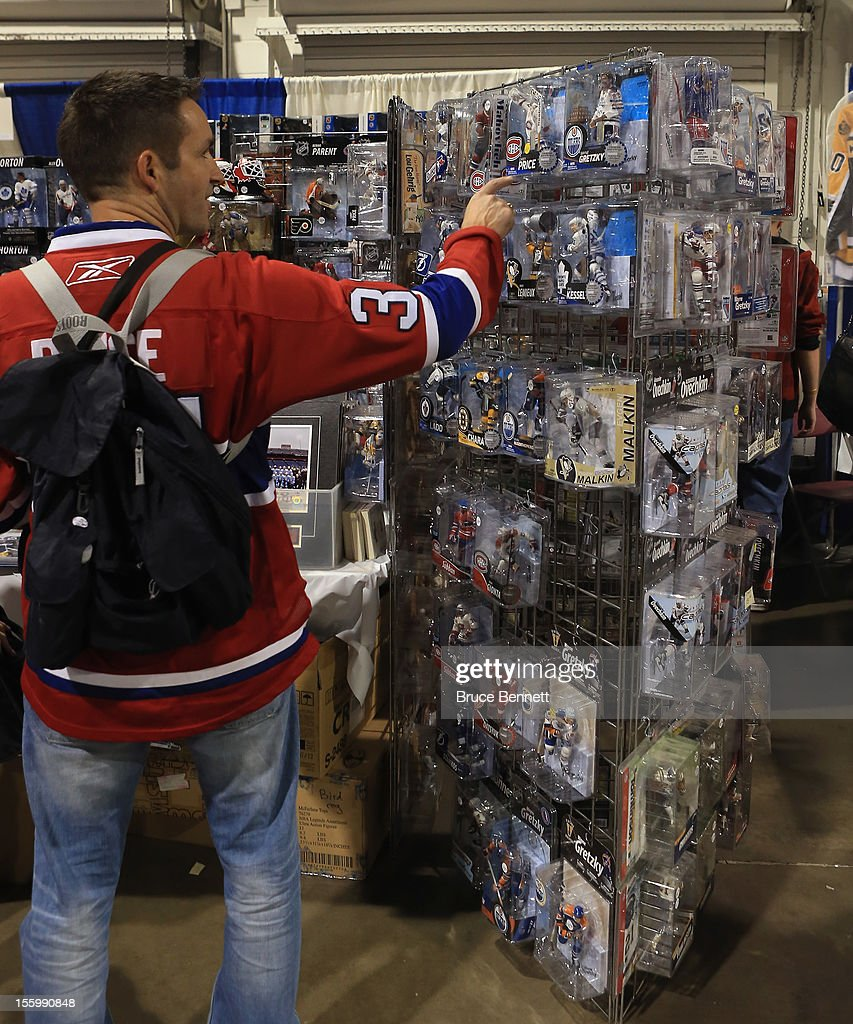 An attendee looks at a display featuring McFarlane figurines at the Sports Card and Memorabilia Expo at the Toronto International Centre on November 10, 2012 in Mississauga, Ontario, Canada.
