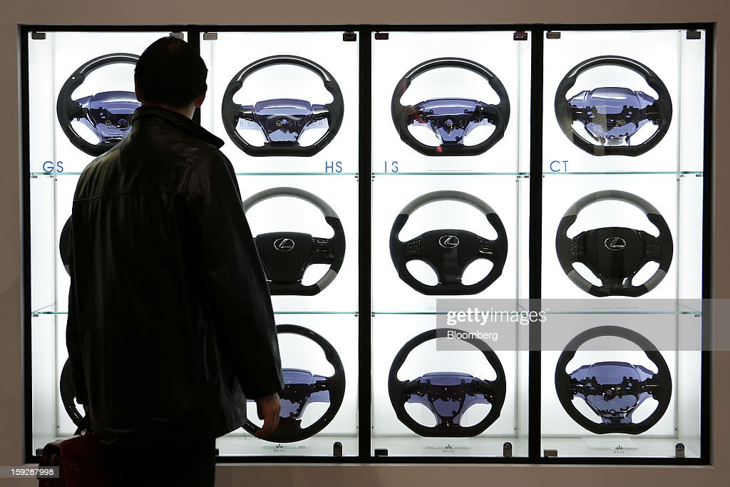 An attendee looks at a display of steering wheels for Toyota Motor Corp.'s Lexus vehicles at the Tokyo Auto Salon 2013 at Makuhari Messe in Chiba, Japan, on Friday, Jan. 11, 2013. The Tokyo Auto Salon runs until Jan. 13. Photographer: Kiyoshi Ota/Bloomberg via Getty Images