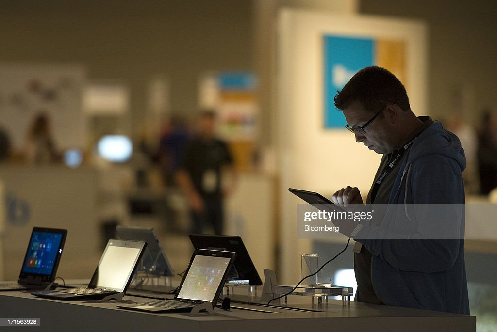 An attendee looks at a Lenovo Group Ltd. ThinkPad Tablet 2 during the Microsoft Corp. Build Developers Conference in San Francisco, California, U.S., on Wednesday, June 26, 2013. Facebook Inc. is building an application for Microsoft Corp.'s Windows 8, adding one of the most popular programs still missing from the operating system designed to help Microsoft gain tablet customers. Photographer: David Paul Morris/Bloomberg via Getty Images