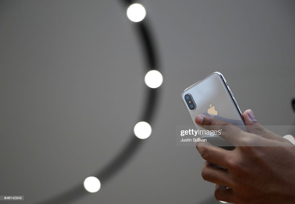 An attendee looks at a new iPhone X during an Apple special event at the Steve Jobs Theatre on the Apple Park campus on September 12, 2017 in Cupertino, California. Apple held their first special event at the new Apple Park campus where they announced the new iPhone 8, iPhone X and the Apple Watch Series 3.