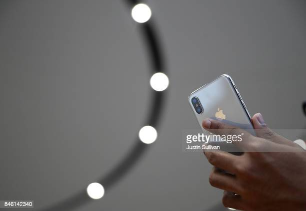 An attendee looks at a new iPhone X during an Apple special event at the Steve Jobs Theatre on the Apple Park campus on September 12 2017 in...