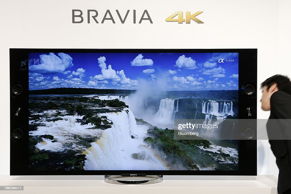 An attendee looks at a Sony Corp. Bravia 4K liquid crystal display (LCD) television displayed at its launch in Tokyo, Japan, on Thursday, April 11, 2013. Sony is sticking with a goal of turning Japan's largest TV-manufacturing business profitable this fiscal year even as it continues losing global market share to Samsung Electronics Co. Photographer: Kiyoshi Ota/Bloomberg via Getty Images