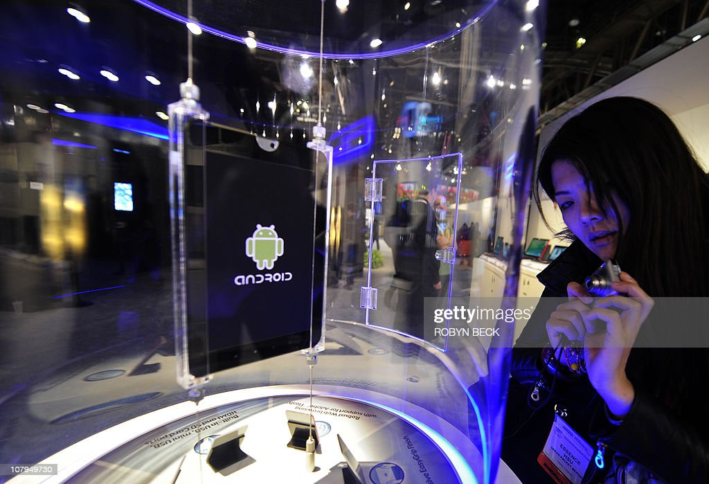 An attendee looks at an as yet unnamed Toshiba tabel running Google's Android at the 2011 International Consumer Electronics Show (CES) January 9, 2011 in Las Vegas, Nevada. Google may not have had any gadgets on display at CES but the Internet giant made its presence felt. While Apple's iPad still rules the tablet roost, Android, which is already widely used by smartphone makers, is shaping up to also be a major force in the tablet arena. AFP PHOTO / Robyn Beck