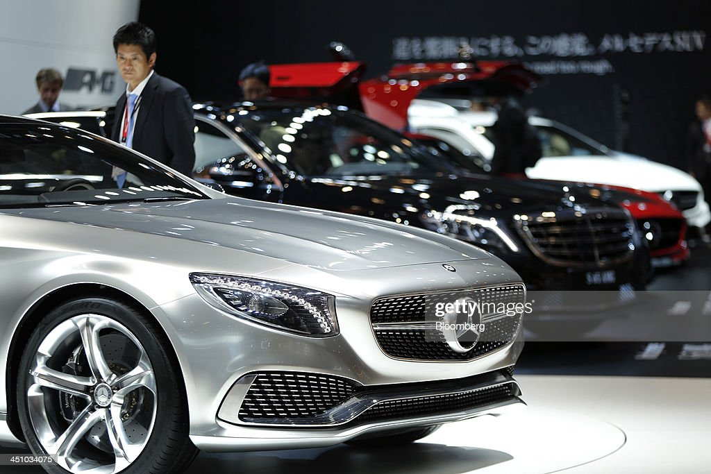 An attendee looks at Daimler AG's Mercedes-Benz Concept S-Class Coupe vehicle on display at the 43rd Tokyo Motor Show 2013 in Tokyo, Japan, on Thursday, Nov. 21, 2013. The autoshow will be open to the public from Nov. 23 to Dec. 1 at the Tokyo International Exhibition Center, also known as the Tokyo Big Sight. Photographer: Kiyoshi Ota/Bloomberg via Getty Images