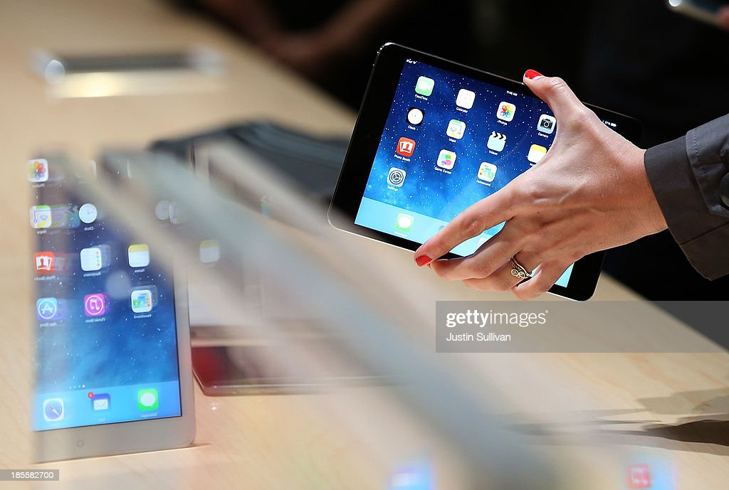 An attendee looks at the new iPad Mini during an Apple announcement at the Yerba Buena Center for the Arts on October 22, 2013 in San Francisco, California. The tech giant announced its new iPad Air, a new iPad mini with Retina display, OS X Mavericks and highlighted its Mac Pro.