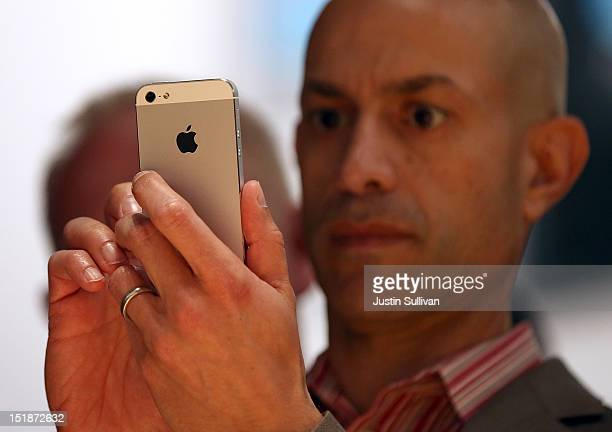 An attendee looks at the new iPhone 5 during an Apple special event at the Yerba Buena Center for the Arts on September 12 2012 in San Francisco...