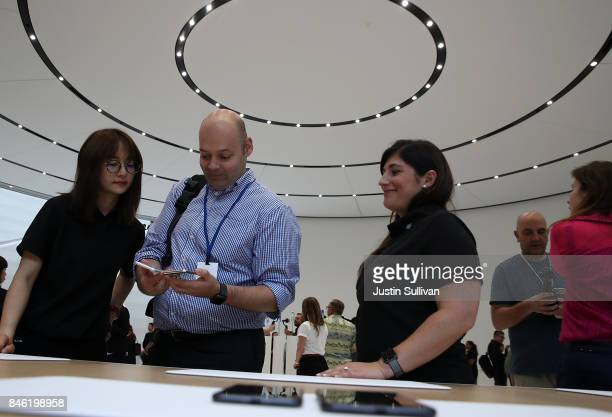 An attendee looks at the new iPhone 8 during an Apple special event at the Steve Jobs Theatre on the Apple Park campus on September 12 2017 in...
