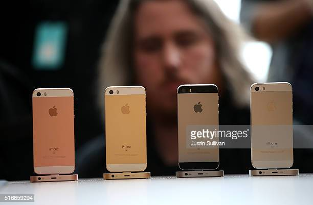 An attendee looks at the new iPhone SE during an Apple special event at the Apple headquarters on March 21 2016 in Cupertino California Apple CEO TIm...