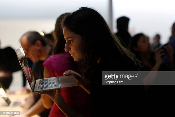 An attendee looks into the new Apple MacBook during a product demonstration after an Apple special event at the Yerba Buena Center for the Arts on...