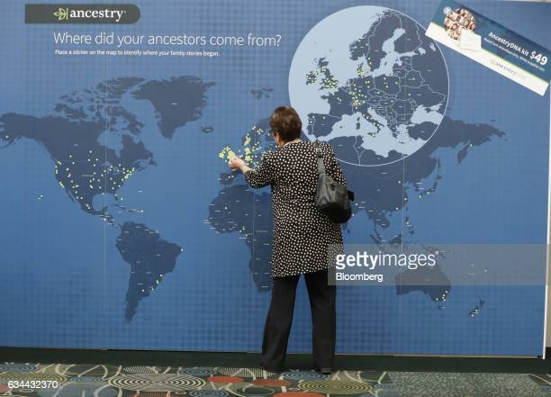An attendee marks an Ancestrycom Inc map displayed on the exhibition floor of the 2017 RootsTech Conference in Salt Lake City Utah US on Thursday Feb...